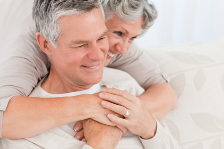 Middleaged couple hugging at home photo