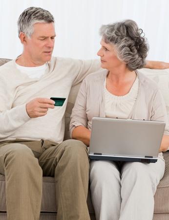 Seniors buying something on internet at home photo