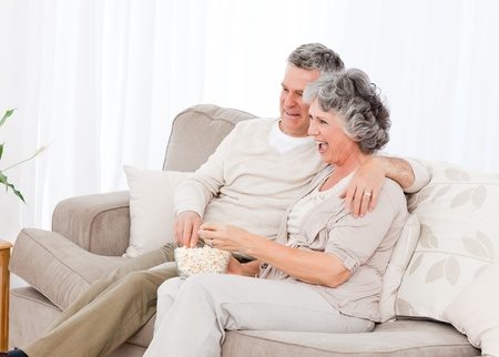 Mature couple taking a photo of themselves at home Stock Photo - 10214578