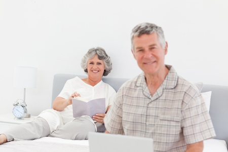 Man talking with his wife at home photo