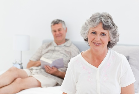 Woman talking with her husband at home photo
