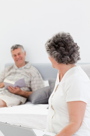 Retired man giving a massage to his wife at home photo