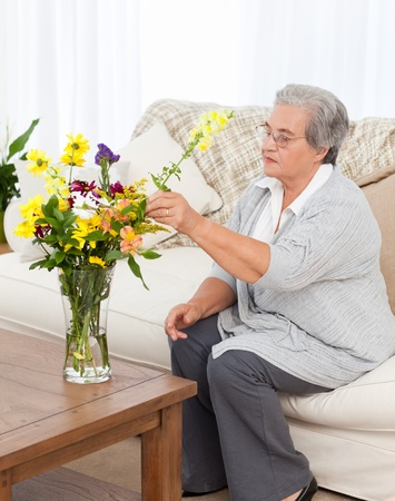 Senior with flowers  at home Stock Photo - 10219643