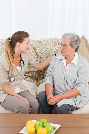 home healthcare: Nurse taking the heartbeat of her patient at home