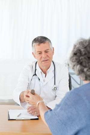 Doctor explaining something to her patient Stock Photo - 10214055