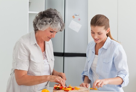 Woman cooking with her mother at home photo