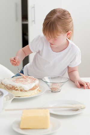 Adorable girl baking in her kitchen at home photo
