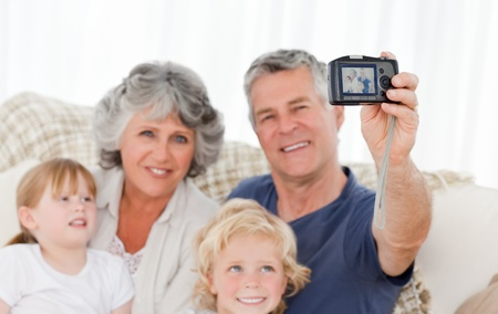 Family taking a photo of themselves at home photo