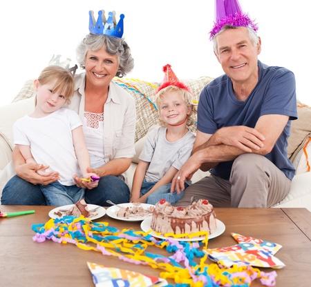 Happy family celebrating birthday at home Stock Photo - 10218432