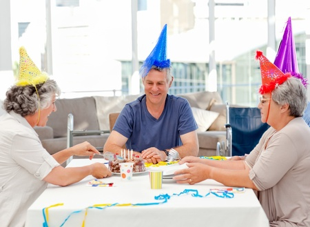 Mature friends on birthday at home photo
