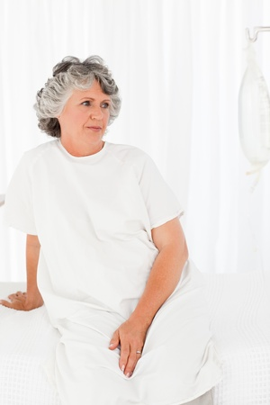 Sad woman in her bedroom at the hospital Stock Photo - 10212819