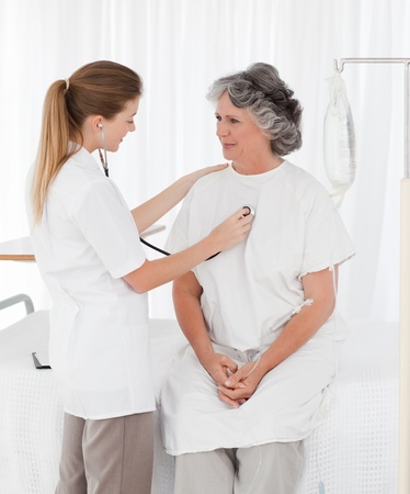 Nurse taking the heartbeat of her patient Stock Photo - 10212560