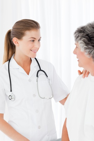 Patient with her nurse smiling Stock Photo - 10212549