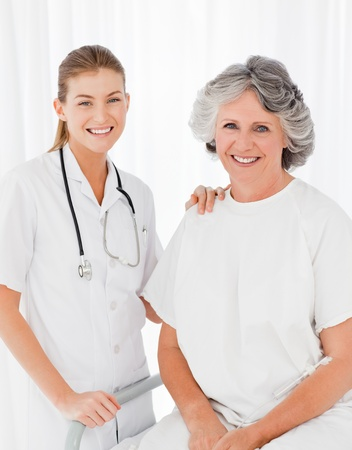Senior with her nurse looking at the camera Stock Photo - 10212501