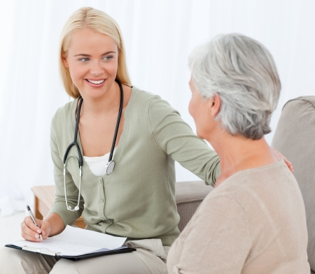 home health care: Doctor talking with her patient