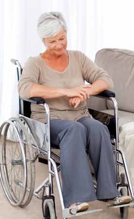 Senior in wheelchair with pills photo