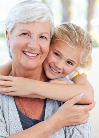 Young girl hugging her grandmother Stock Photo - 10218979