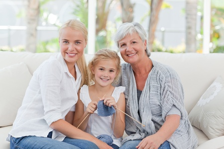 matured: Beautiful family looking at the camera at home Stock Photo