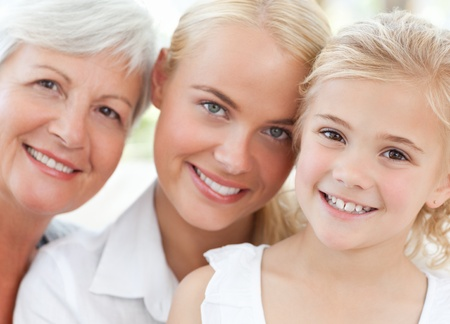 smiling faces: Portrait of a joyful family looking at the camera at home Stock Photo