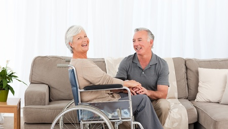 Man with his wife in a wheelchair photo