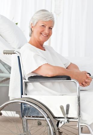 Mature woman in a wheelchair photo