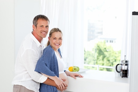Couple hugging in the kitchen at home Stock Photo - 10217580