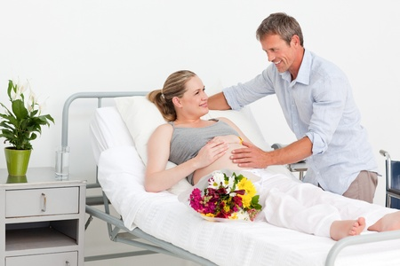 Adorable couple in a hospital room photo