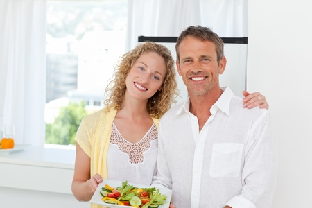 Lovely couple in the kitchen photo