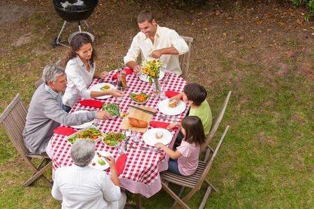 Family eating outside in the garden Stock Photo - 10197871