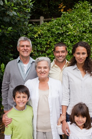 landlady: Smiling family in the garden  Stock Photo
