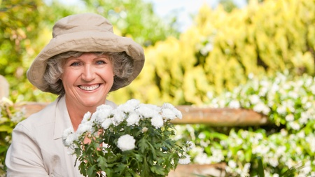 Mature woman with flowers looking at the camera