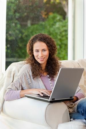 landlady: Smiling woman with her laptop