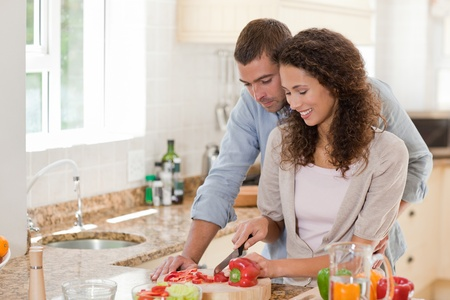 Man eating vegetables with his wife at home photo