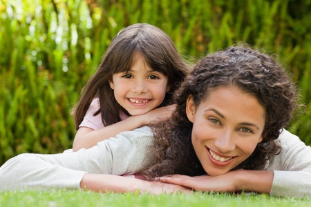 Adorable mother with her daughter in the garden photo