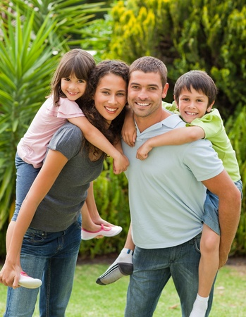piggyback: Mother and father giving children a piggyback