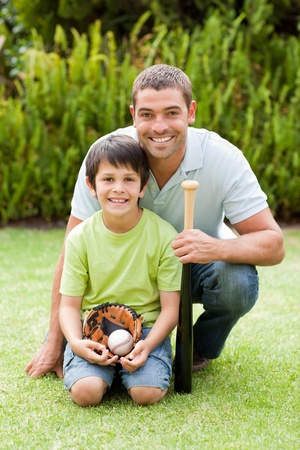 Happy father and his son playing baseball photo