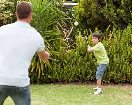 Happy father and his son playing baseball Stock Photo - 10198282