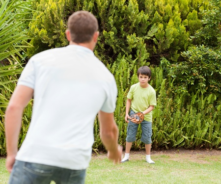 landlady: Father and his son playing baseball Stock Photo