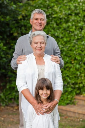 grandaughter: Mature couple with their grandaughter in the garden Stock Photo