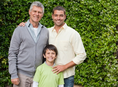 Father and his son looking at the camera in the garden photo