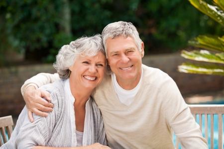 Senior couple hugging in the garden Stock Photo - 10198457
