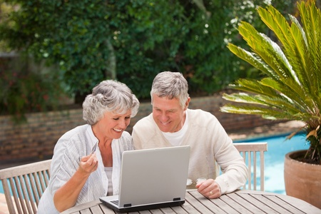 Retired couple buying something on internet photo