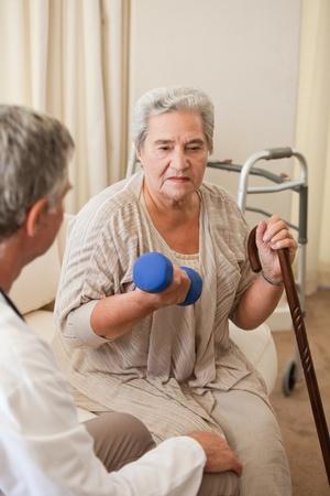 Senior woman doing her exercises photo