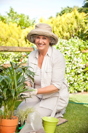lean on hands: Mature woman in the garden Stock Photo
