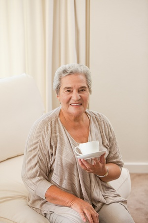 Senior couple with a cup of coffee photo