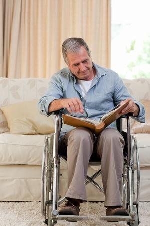 Senior man looking at his photo album photo