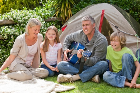 Happy family camping in the garden photo