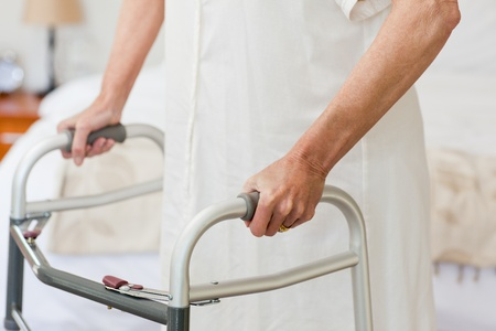 citizens: Senior woman with her zimmer frame Stock Photo