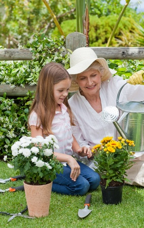 Grandmother with her granddaughter working in the garden Stock Photo - 10197944