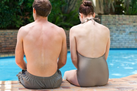 Couple sitting beside the swimming pool Stock Photo - 10173964